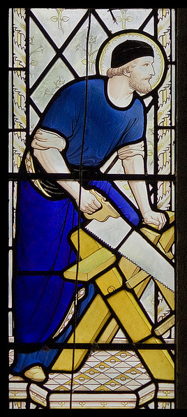 Joseph the carpenter depicted in stained glass
